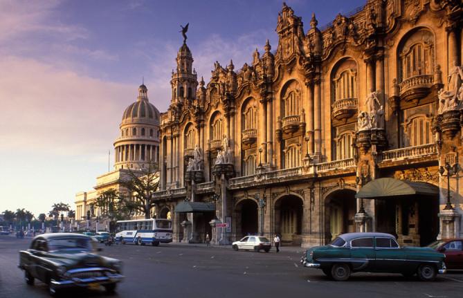 Old cars passing the Gran Teatro Capitolio Habana Vieja Havana Cuba