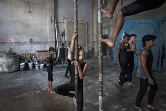 Children practise during a training session at a circus school in Havana