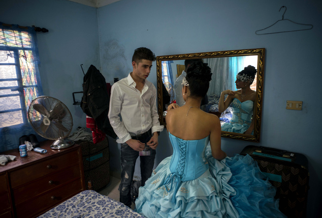 "In this Dec. 20, 2015 photo, Daniela Santos Torres, 15, speaks with her boyfriend Erick before her quinceanera party in the town of Punta Brava near Havana, Cuba. Daniela left Cuba when she was 3, returning in December for her quinceanera photos and party. She now lives in Glendale, Arizona, where her father runs a home remodeling business. She said returning to Cuba for her celebration was ""a dream,"" allowing her to include her extended family and friends on the island. (AP Photo/Ramon Espinosa)"