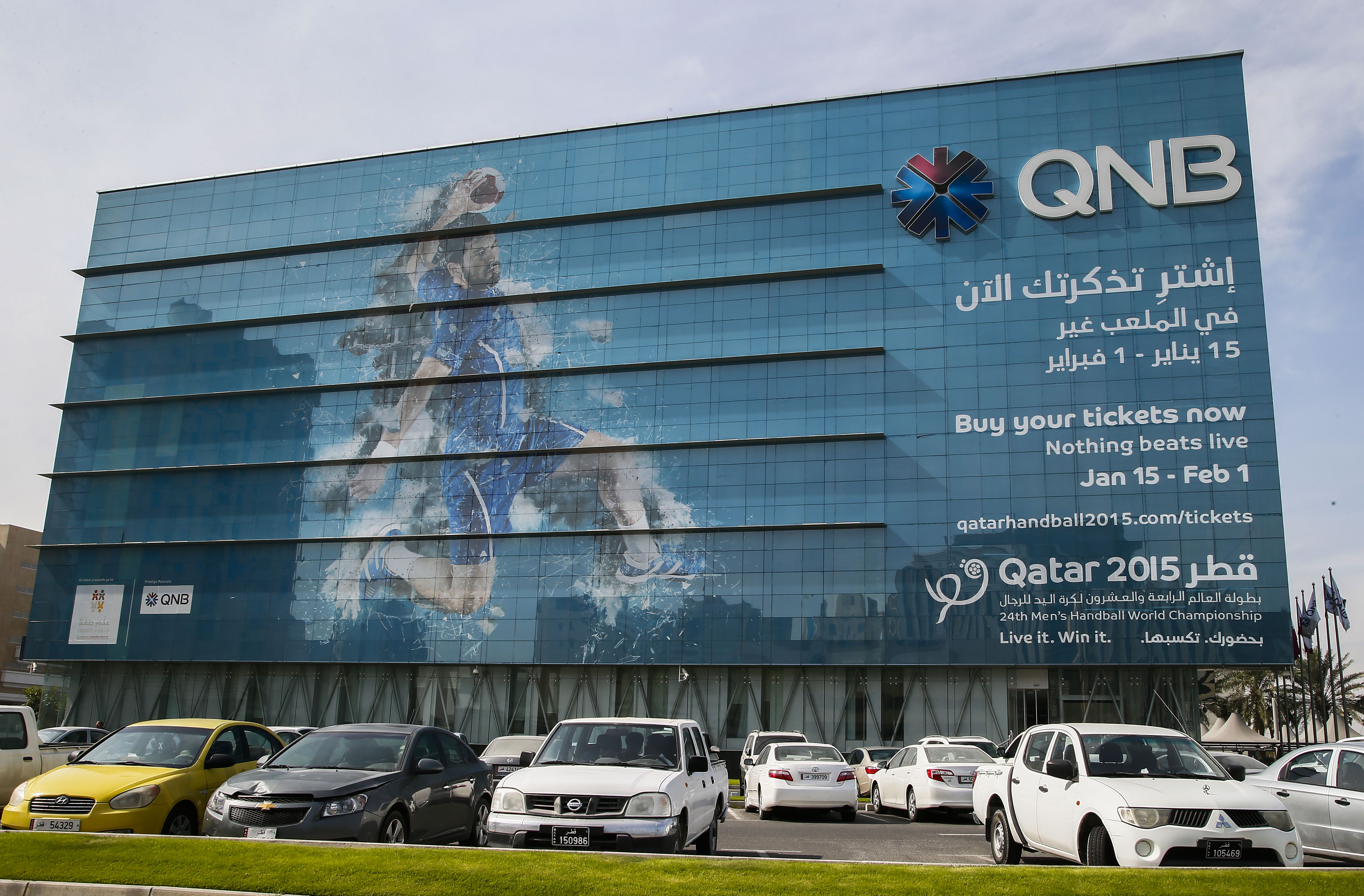 epa04558258 A promotion for the men's Handball World Championship 2015 covers the Qatar National Bank (QNB) Corperate Head Office in Doha, Qatar, 13 January 2015. The Qatar 2015 men's Handball World Championship 2015 takes place in Qatar from 15 January to 01 February. Qatar 2015 via epa/NIC BOTHMA Editorial Use only/No Commercial sales