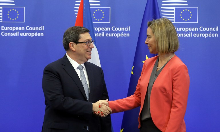 EU High Representative for Foreign Affairs Federica Mogherini (R) welcomes Cuban Foreign Minister Bruno Rodriguez Parrilla at the start of an EU-Cuba political dialogue and cooperation agreement in Brussels on December 12, 2016. / AFP PHOTO / EMMANUEL DUNAND