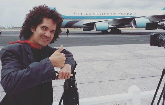 Air Force One photographer Yander Zamora receives the King