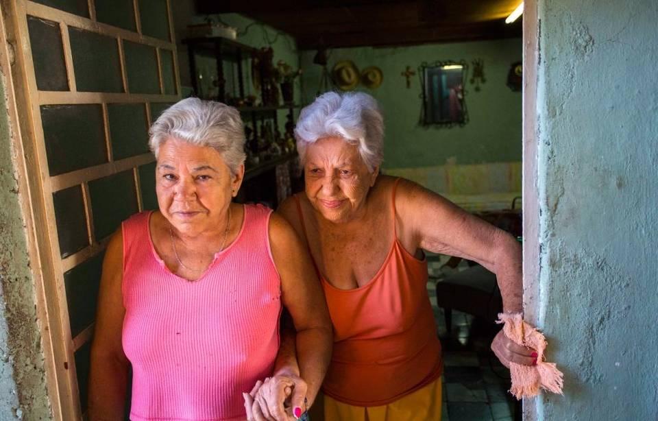 Magaly Gonzalez Martinez, 66, and her mother Cristina Gonzalez Martinez, 82, in Havana. Desmond Boylan AP