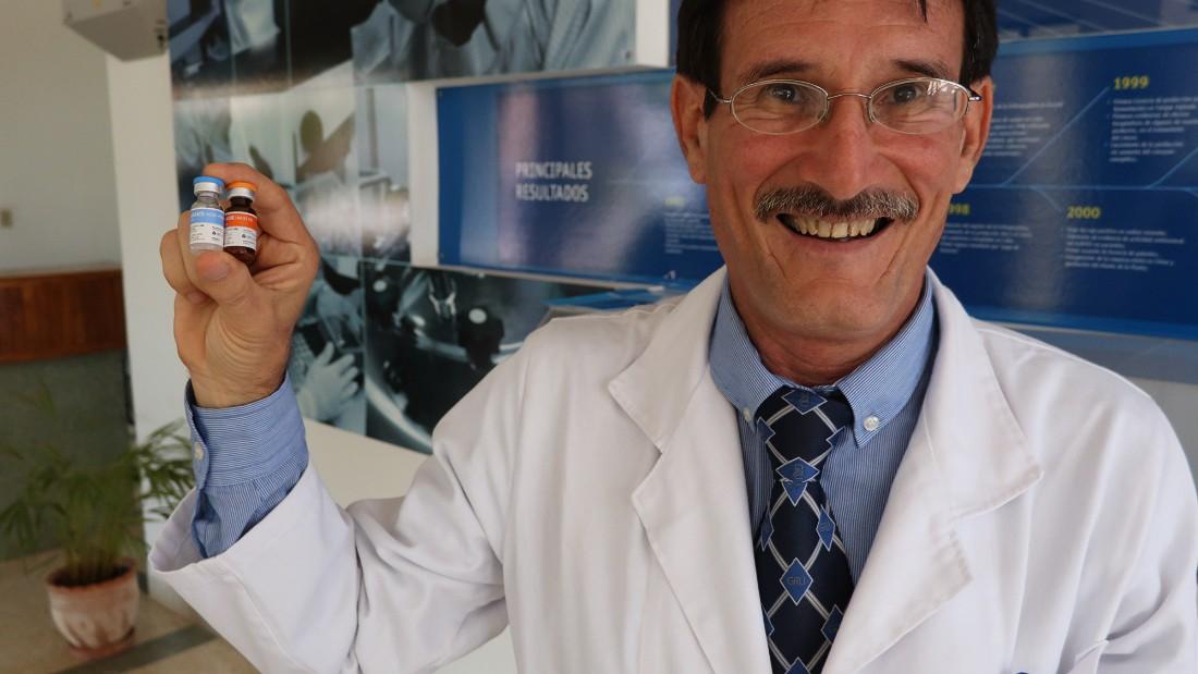 havana-live-cim-researcher-holding-vaccine-super-169