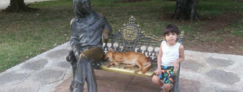 DOG SLEEPS NEXT TO THE JOHN LENNON STATUE IN HAVANA AFTER BEING ABANDONED