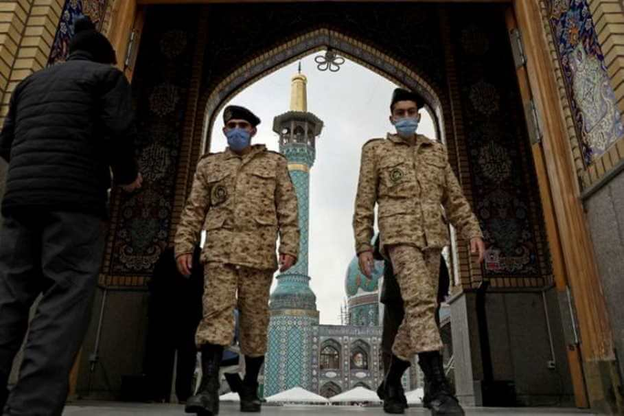 Iranian soldiers leave Tehran's Imamzadeh Saleh shrine amid the COVID-19 outbreak