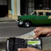 Cuba gripped in dollar frenzy, peso under pressure
