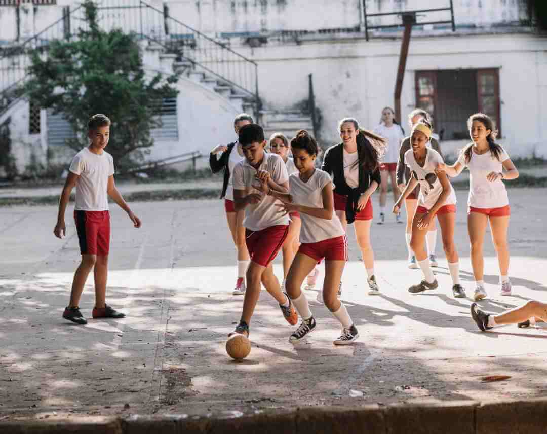 Playing outdoors, in the street, still a way of life in Cuba